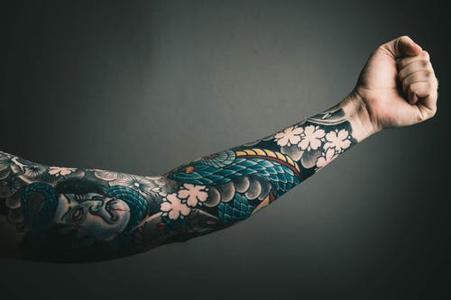 Discusses Tattoo Design and Tattoo Placement
